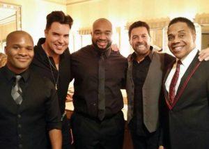 Molodi Founders Jason Nious and Antwan Davis surround Entertainer Frankie Moreno with Earl
