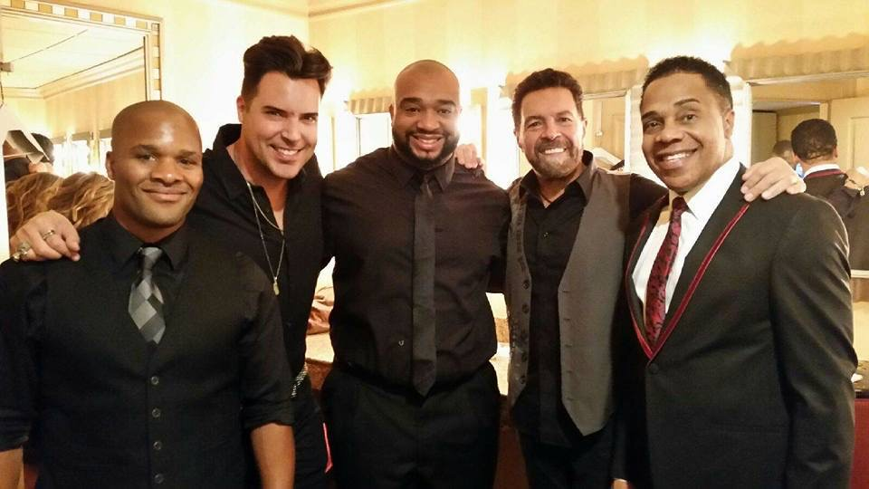 Molodi Founders Jason Nious and Antwan Davis surround Entertainer Frankie Moreno with Earl